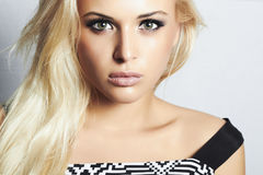 Beautiful blond girl with green eyes.woman.professional make-up Stock Images