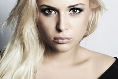 Beautiful blond girl with green eyes. woman. professional make-up royalty free stock photography