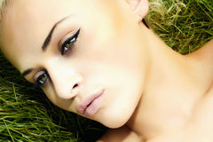 Beautiful blond girl on green grass. beauty woman. summer Stock Image