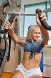 Beautiful blond girl at the gym Stock Image