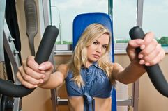 Beautiful blond girl at the gym Royalty Free Stock Photography