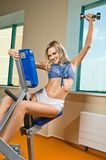 Beautiful blond girl at the gym Stock Photos