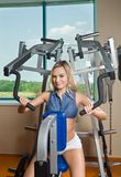 Beautiful blond girl at the gym Royalty Free Stock Images