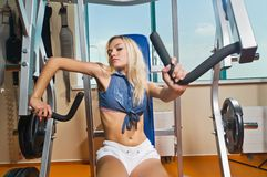 Beautiful blond girl at the gym Royalty Free Stock Photos