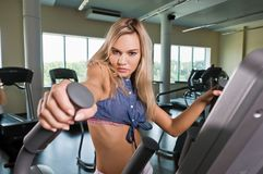 Beautiful blond girl at the gym Royalty Free Stock Image