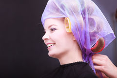 Beautiful blond girl hair curlers rollers hairdresser beauty salon Royalty Free Stock Images