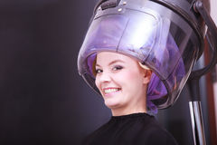 Beautiful blond girl hair curlers rollers hairdresser beauty salon Stock Images