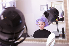 Beautiful blond girl hair curlers rollers hairdresser beauty salon Stock Image