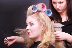 Beautiful blond girl hair curlers rollers hairdresser beauty salon Stock Photo
