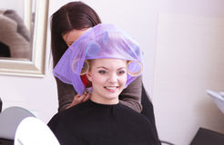 Beautiful blond girl hair curlers rollers hairdresser beauty salon Stock Photography