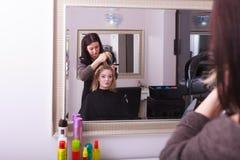 Beautiful blond girl hair curlers rollers hairdresser beauty salon Stock Photos
