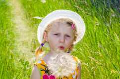 Beautiful blond girl in hat and flower Royalty Free Stock Photo