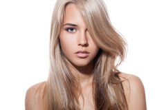 Beautiful Blond Girl. Healthy Long Hair. White Background Royalty Free Stock Photography