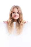 Beautiful blond girl holding an empty white board. Face and hair of a beautiful blond girl holding an empty white board, isolated Royalty Free Stock Images