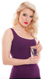 Beautiful blond girl holding glass of water Stock Photography