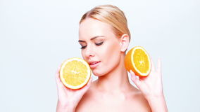 Beautiful Blond Girl Holding Orange Fruit stock video footage