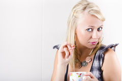 Woman Holding Teabag And Mug In Kitchen Royalty Free Stock Image