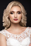 Beautiful blond girl  in image of the bride. Beauty face. Royalty Free Stock Images