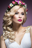 Beautiful blond girl in the image of a bride with flowers in her hair. Beauty face. Wedding image Royalty Free Stock Images
