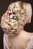 Beautiful blond girl  in image of the bride with purple flowers on her head. Beauty face.  Hairstyle back view Royalty Free Stock Image