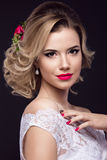 Beautiful blond girl  in image of the bride with purple flowers on her head. Beauty face Royalty Free Stock Image
