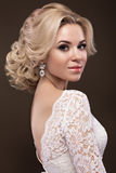 Beautiful blond girl in image of the bride with purple flowers on her head. Beauty face stock photography