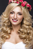 Beautiful blond girl in image of the bride with purple flowers on her head. Beauty face. Royalty Free Stock Photography