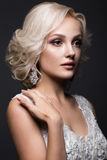 Beautiful blond girl in image of the bride with wedding accessories on her head. Beauty face. Royalty Free Stock Images