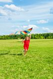 Beautiful blond girl with kite Royalty Free Stock Photo