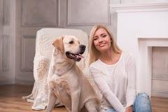 Beautiful  blond girl with Labrador Retriever Stock Photo