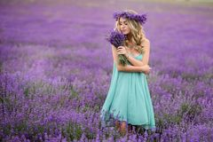 Beautiful girl on the lavender field. Beautiful blond girl on the lavender field royalty free stock photography