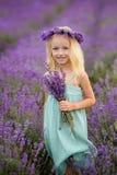 Beautiful girl on the lavender field. Beautiful blond girl on the lavender field stock photography