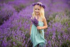 Beautiful girl on the lavender field. Beautiful blond girl on the lavender field royalty free stock image
