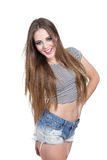 Beautiful blond girl with long hair wearing shorts Royalty Free Stock Photos