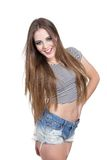Beautiful blond girl with long hair wearing shorts Stock Photos