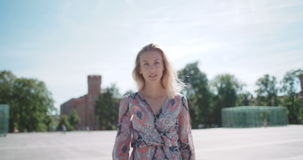 Beautiful blond girl looking at camera and smiling. stock video footage