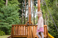 Beautiful blond girl. Lovely blond little girl in playground Royalty Free Stock Photography