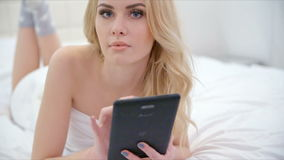 Beautiful Blond Girl Lying on Bed stock video