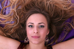 Beautiful blond girl lying on her back Royalty Free Stock Image