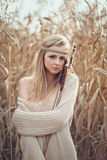 Beautiful blond girl with a mirror in the reeds Stock Photography