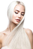 Beautiful blond girl in move with a perfectly smooth hair, and classic make-up. Beauty face. royalty free stock image