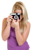 Beautiful blond girl with old camera. Isolated Royalty Free Stock Image