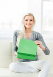 Beautiful blond girl opening a gift Stock Photos