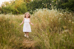 Beautiful blond girl outdoor on the hill on a summer day Royalty Free Stock Images