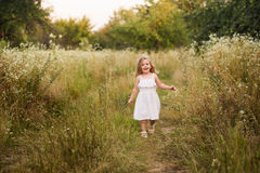 Beautiful blond girl outdoor on the hill on a summer day Stock Photos
