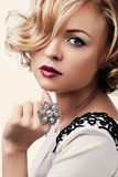 Beautiful blond girl with a pearl ring Royalty Free Stock Photo