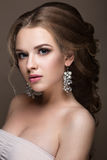 Beautiful blond girl with perfect skin, evening make-up, wedding hairstyle and accessories. Beauty face. royalty free stock image