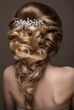 Beautiful blond girl with perfect skin, evening make-up, wedding hairstyle and accessories. Beauty face. royalty free stock photography