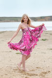 Beautiful blond girl in pink Royalty Free Stock Photo