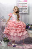 Beautiful blond girl in a pink dress Royalty Free Stock Image